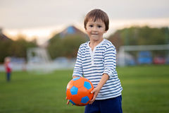 Little toddler boy playing soccer and football, having fun outdo Royalty Free Stock Image