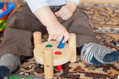 Little toddler boy playing with wooden toys Stock Photography