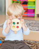 Little toddler boy playing with wooden toys Royalty Free Stock Image