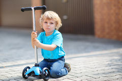 Little toddler boy riding on his bycicle in summer Stock Photography