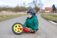 Little toddler boy sad about his broken bicycle Royalty Free Stock Photography