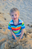 Little toddler boy sitting sandy beach Stock Photography