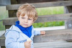 Little toddler boy sitting on wooden stairs Royalty Free Stock Photos