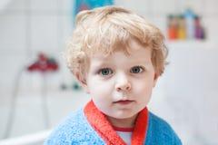 Little toddler boy after taking a bath. Adorable little toddler boy after taking a bath in bathtub Stock Photos
