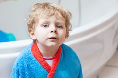Little toddler boy after taking a bath. Adorable little toddler boy after taking a bath in bathtub Stock Photo