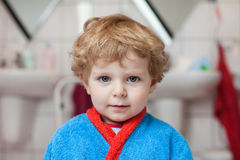 Little toddler boy after taking a bath. Adorable little toddler boy after taking a bath in bathtub Royalty Free Stock Image