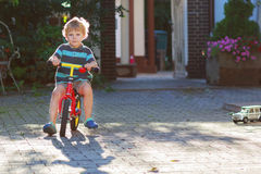 Little toddler boy of 3 years having fun on his  bicycle Royalty Free Stock Image