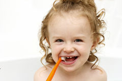 Little toddler brushing teeth in the bath Stock Photography