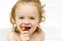 Little toddler brushing teeth in the bath Royalty Free Stock Image