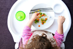 Little toddler child eats vegetables Royalty Free Stock Photography