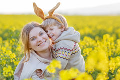 Little toddler child and his mother in Easter bunny ears having Stock Photo
