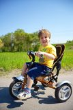 Little toddler child on three-wheeled bicycle Stock Photography