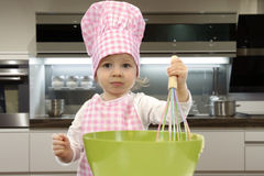 Little toddler cooking pastry Stock Images