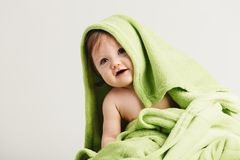 Little toddler covered in cozy blanket. Funny sweet baby. Childhood Royalty Free Stock Photography