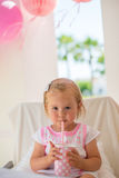 Little Toddler Drinking Juice From Paper Cup Stock Image