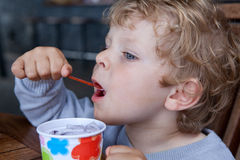 Little toddler eating ice cream summer Royalty Free Stock Photography