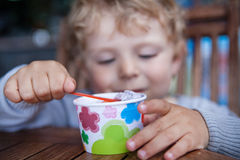 Little toddler eating ice cream summer Royalty Free Stock Image