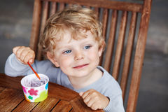 Little toddler eating ice cream summer Royalty Free Stock Photo