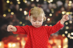 Little toddler in front of a Christmas tree Stock Images