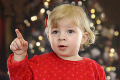 Little toddler in front of a Christmas tree Stock Photos