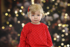 Little toddler in front of a Christmas tree Stock Photography