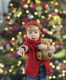 Little toddler in front of a christmas tree Royalty Free Stock Photos
