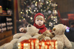Little toddler in front of a christmas tree Royalty Free Stock Photo