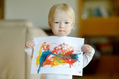 Little toddler girl displaying her picture Stock Images