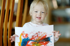 Little toddler girl displaying her picture Royalty Free Stock Photo
