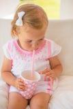 Little Toddler Girl Drinking Lemon Water Stock Photography
