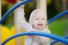 Little toddler girl having fun Stock Images