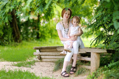 Little toddler girl and her mother Stock Photo