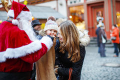 Little toddler girl with mother on Christmas market. Royalty Free Stock Photography