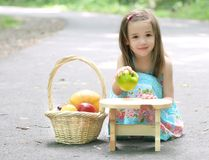 Little Toddler Girl in Park Playing with Fruit Royalty Free Stock Images
