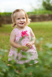Little toddler girl in pink dress. Smiling Royalty Free Stock Image