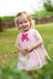 Little toddler girl in pink dress. Smiling Royalty Free Stock Photo