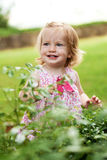 Little toddler girl in pink dress. Smiling Royalty Free Stock Photos