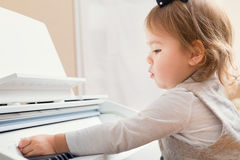 Little toddler girl playing piano Stock Image