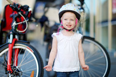 Little toddler girl ready to ride a bike Royalty Free Stock Photography