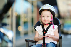 Little toddler girl ready to ride a bike Royalty Free Stock Photos