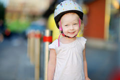 Little toddler girl ready to ride a bike Stock Photo