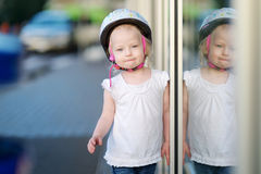 Little toddler girl ready to ride a bike Stock Image