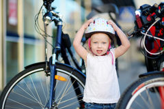 Little toddler girl ready to ride a bike Stock Images