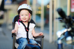 Little toddler girl ready to ride a bike Royalty Free Stock Image