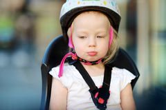 Little toddler girl ready to ride a bike Royalty Free Stock Photo