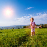 Little toddler girl running in a beautiful field Royalty Free Stock Photography