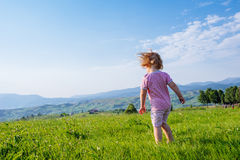 Little toddler girl running in a beautiful field Royalty Free Stock Images