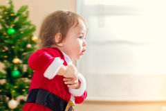 Little toddler girl running to open Christmas presents Royalty Free Stock Photo