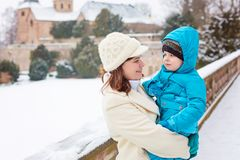 Little toddler kid boy and mother having fun with snow on winter day Royalty Free Stock Photography