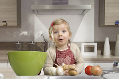 Little toddler in the kitchen Royalty Free Stock Image